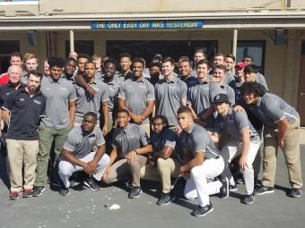 Football Team Poses for Photo at Naval Base