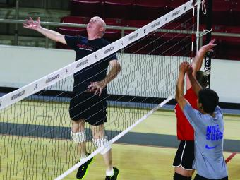 Physics Professor Dan Boye playing in the Recreational Volleyball Team