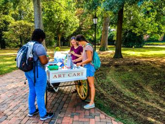 Student complete crafts at the Art Cart, stationed on campus