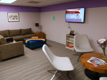 Photo of Lavender Lounge with purple walls and modern furniture