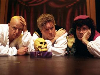 Reduced Shakespeare Company cast laying on stage