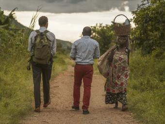 Ross Boyce with people from Uganda walking to water