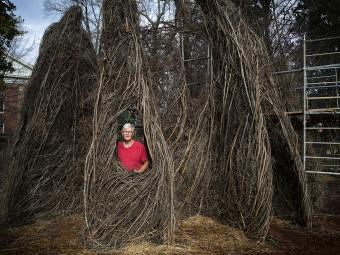 Patrick Dougherty Sculpture with artist