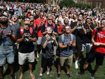 Davidson community on the green during the eclipse