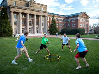 Playing ball outside Chambers - Warm February Weather Brings Students Out