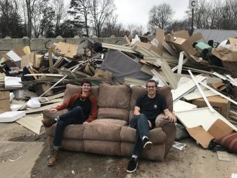 Mike Bauman and Jack Mathieson in a junk yard