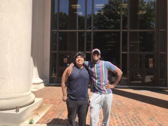 Jose Hernandez and Roy Toston in front of Davidson library