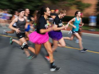 Cake Race Runners Speed by in Tutus