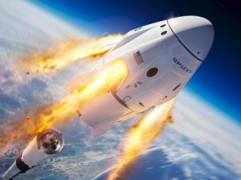 Dragon space capsule over Earth