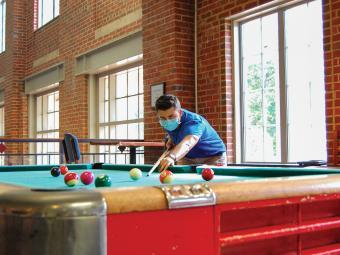Student Plays Pool with Mask On