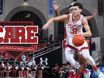 Kellan Grady Dribbles Ball During Basketball Game, CARE logo is overlaid