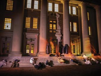 Students act out a zombie scene on Chambers steps