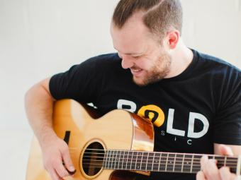 George Ramsay '13 of Bold Music Plays Guitar