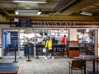 Davis Café Exterior within Davidson College's College Union and Students with Take-Away Food