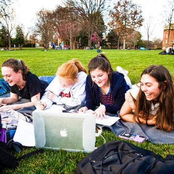 Students Studying & Laughing on Lawn